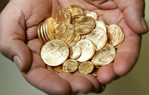 Gold Coins In Cupped Hands